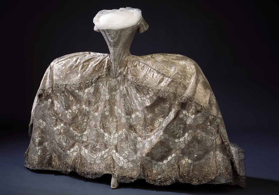 http://madameguillotine.files.wordpress.com/2012/02/18th-century-court-gown-cloth-of-silver.jpeg